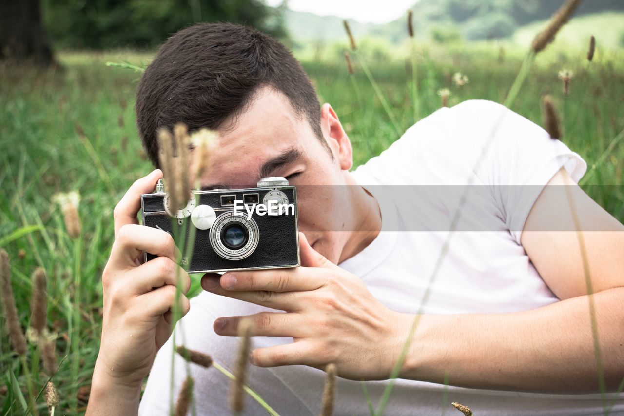 Man photographing plants with camera