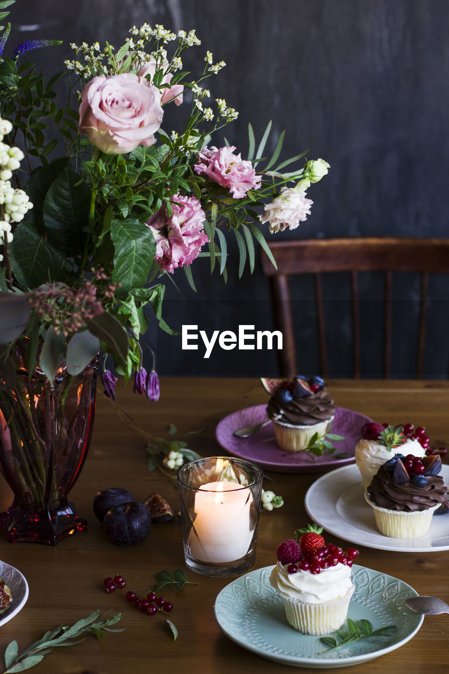 CLOSE-UP OF CAKE SERVED ON TABLE BY POTTED PLANT