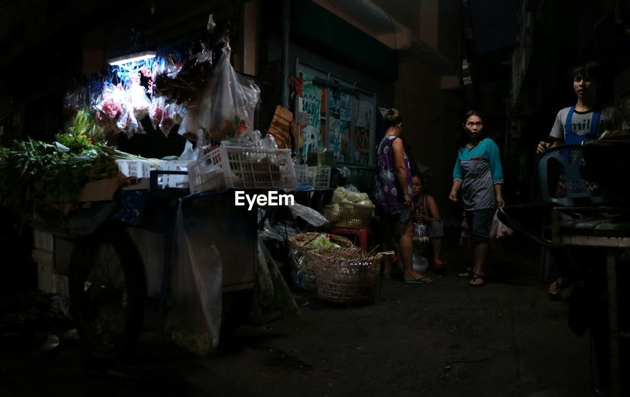 night, real people, market, retail, men, food, outdoors, full length, standing, one person, freshness, people