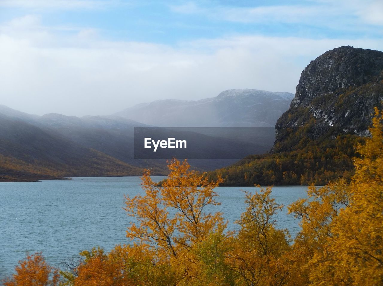 water, mountain, beauty in nature, sky, scenics - nature, tranquil scene, plant, tranquility, nature, lake, mountain range, tree, day, cloud - sky, non-urban scene, no people, idyllic, environment, autumn, outdoors, change, mountain peak