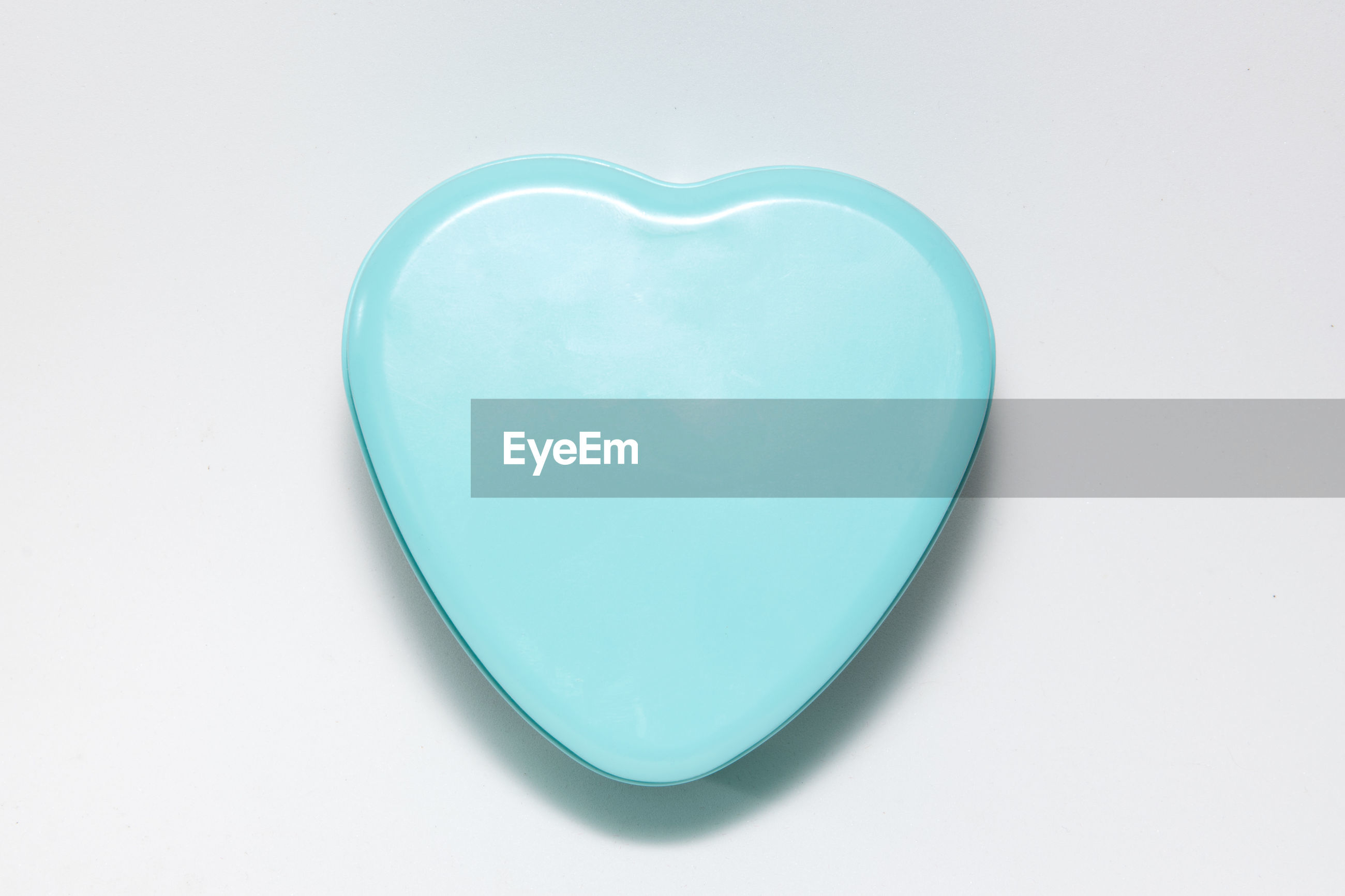 Heart shaped gift box over white background