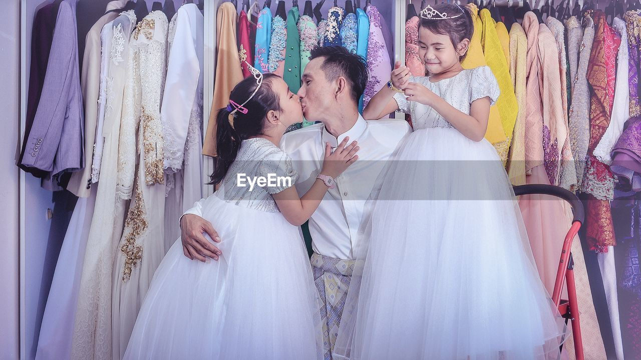 wedding dress, clothing, wedding, celebration, bride, women, store, fashion, happiness, newlywed, emotion, adult, choice, retail, young adult, shopping, clothing store, event, indoors, smiling, beautiful woman, positive emotion, daughter, consumerism