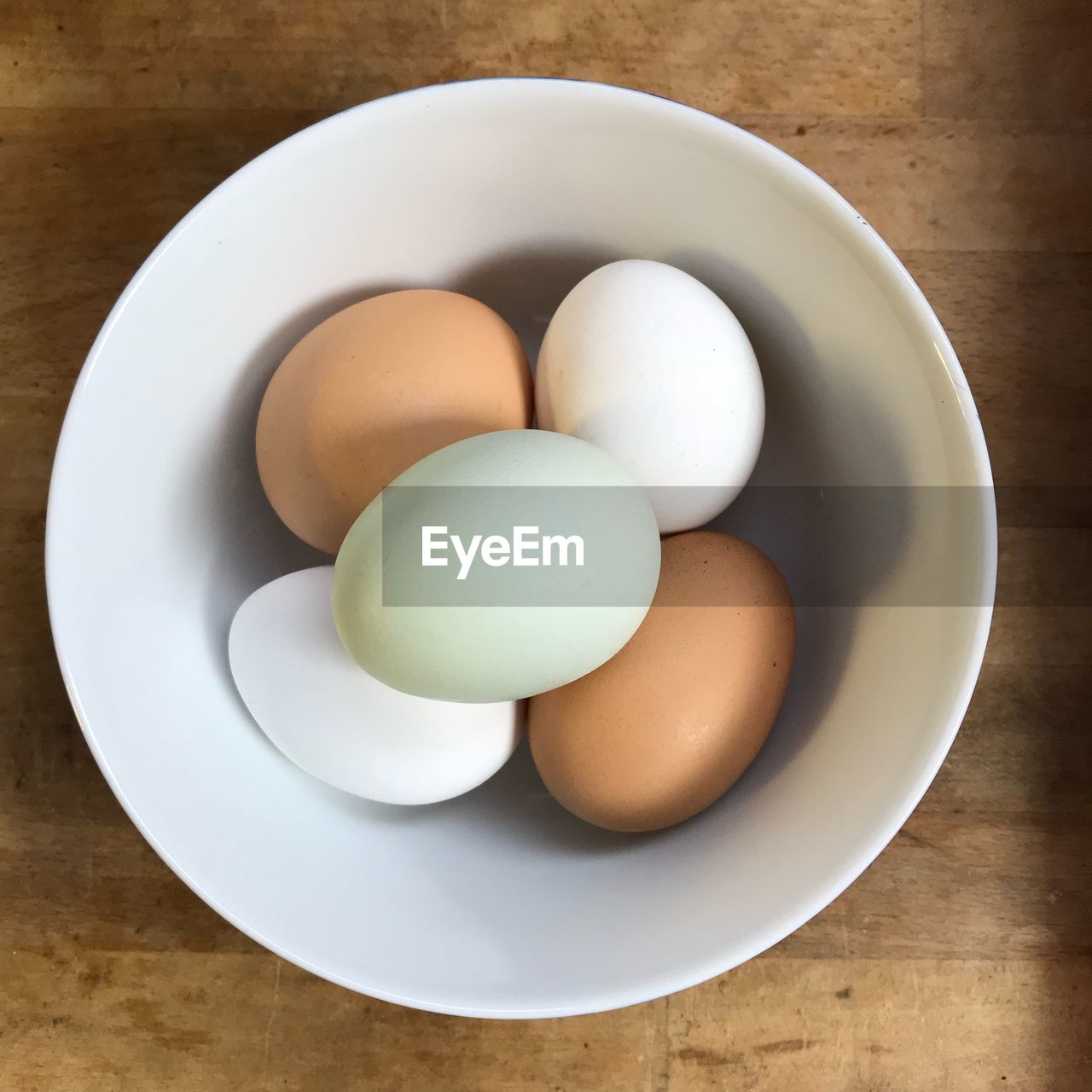 egg, food and drink, table, food, indoors, still life, freshness, bowl, no people, boiled egg, eggshell, high angle view, plate, protein, directly above, eggcup, close-up, healthy eating, egg yolk, day
