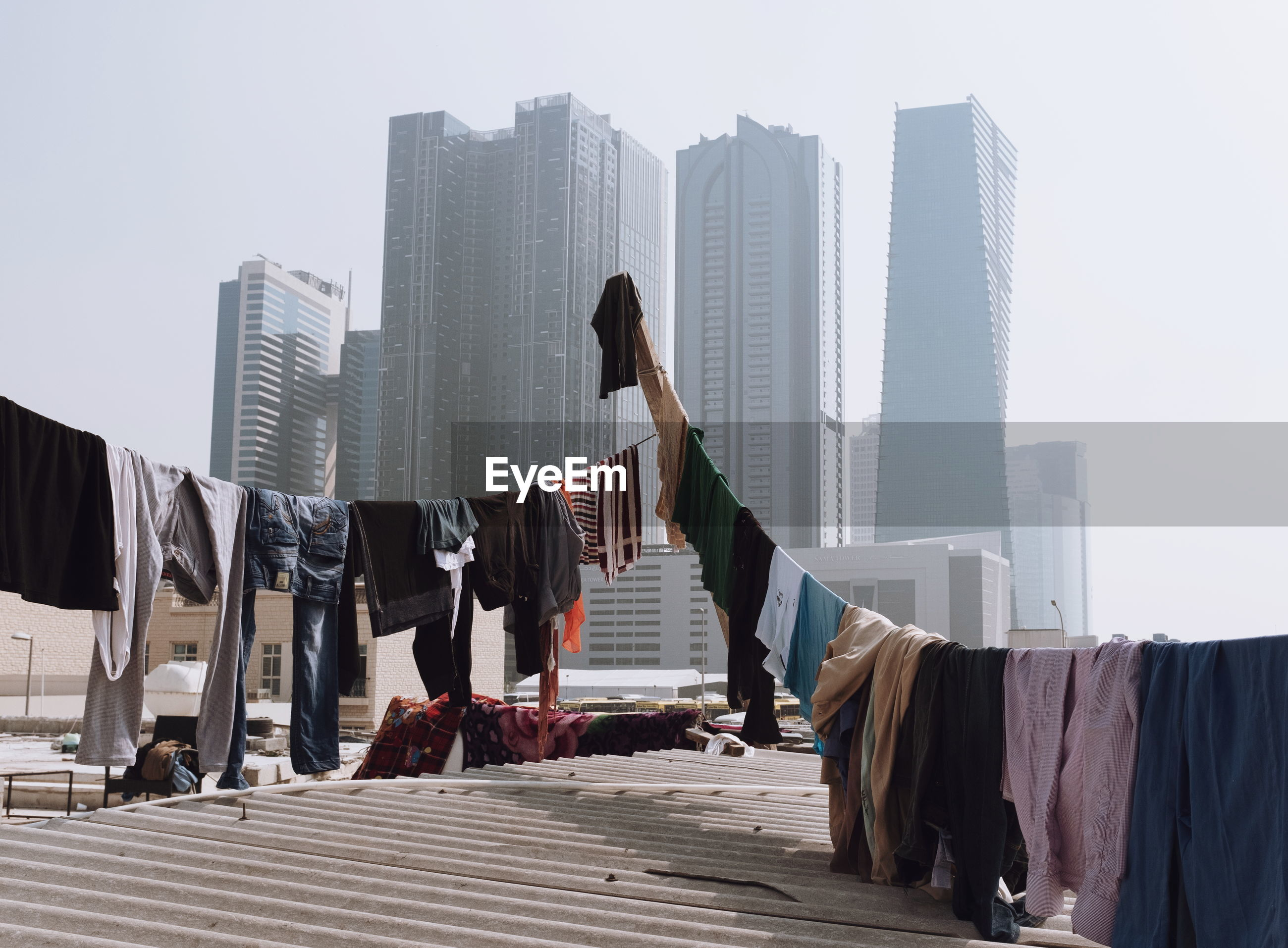 CLOTHES DRYING AGAINST BUILDINGS IN CITY