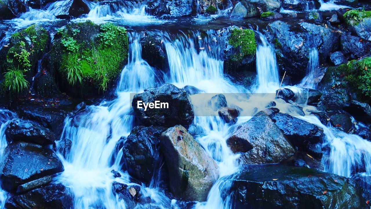 motion, waterfall, long exposure, water, blurred motion, flowing water, rock - object, nature, beauty in nature, splashing, no people, scenics, river, outdoors, day