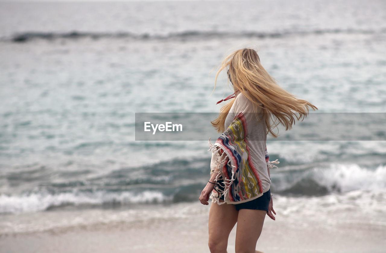 Young woman enjoying at beach