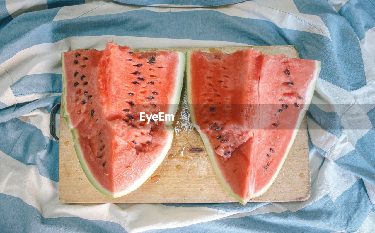 food, food and drink, freshness, indoors, healthy eating, high angle view, fruit, wellbeing, no people, still life, directly above, watermelon, slice, close-up, dairy product, table, melon, ready-to-eat, tablecloth, bread, tray