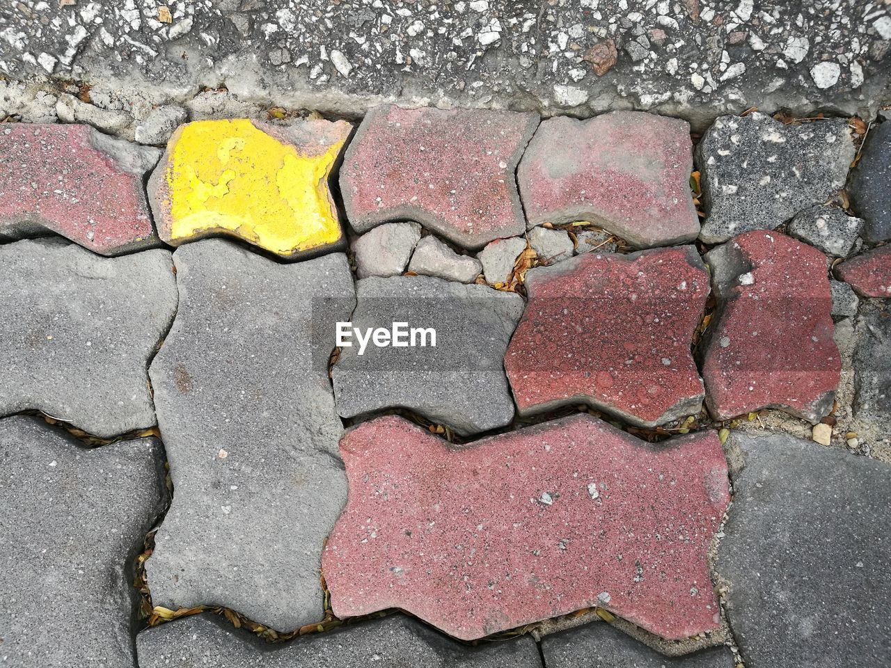 textured, no people, pattern, street, backgrounds, cracked, yellow, road, full frame, day, outdoors, close-up
