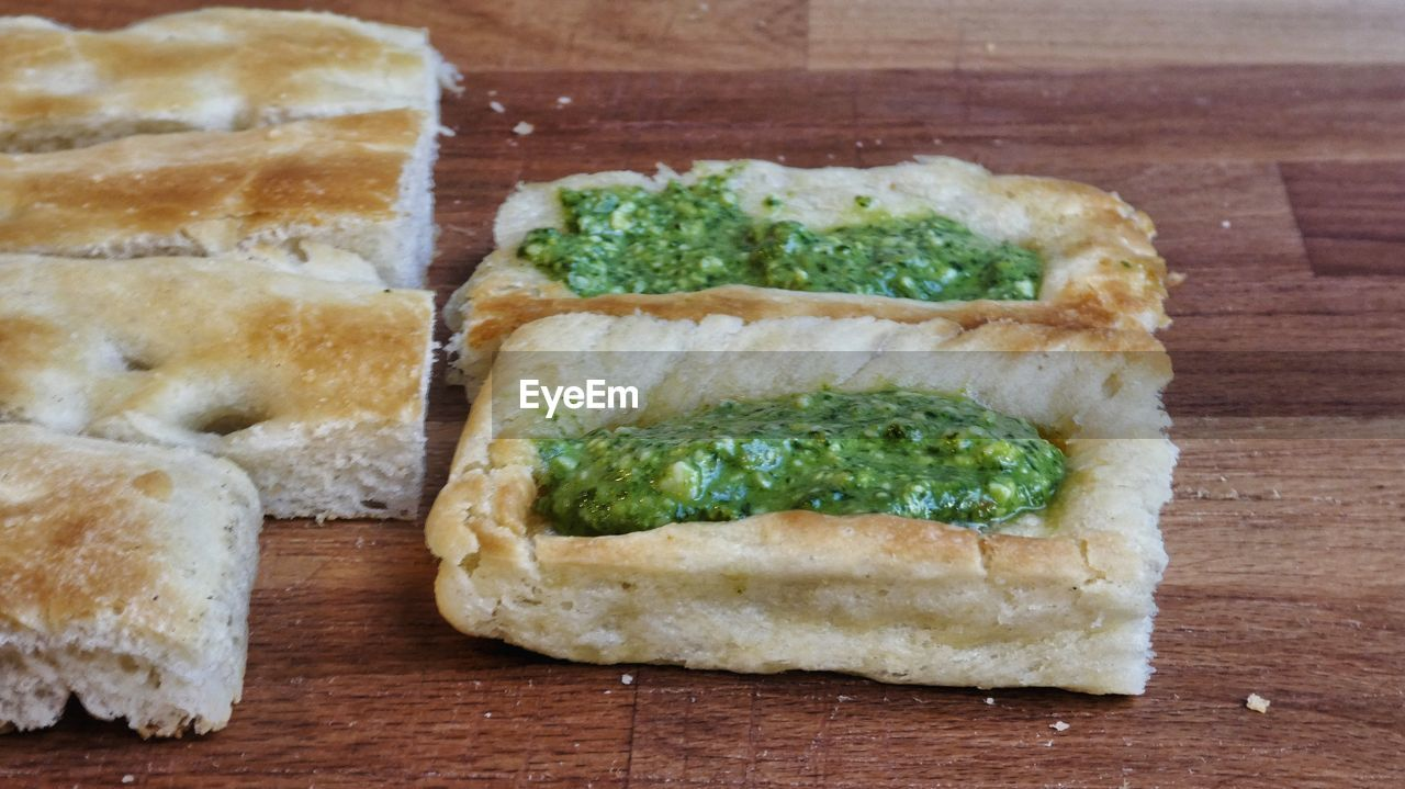 Close-up of typical food of genova - foccacia with green pesto genovese