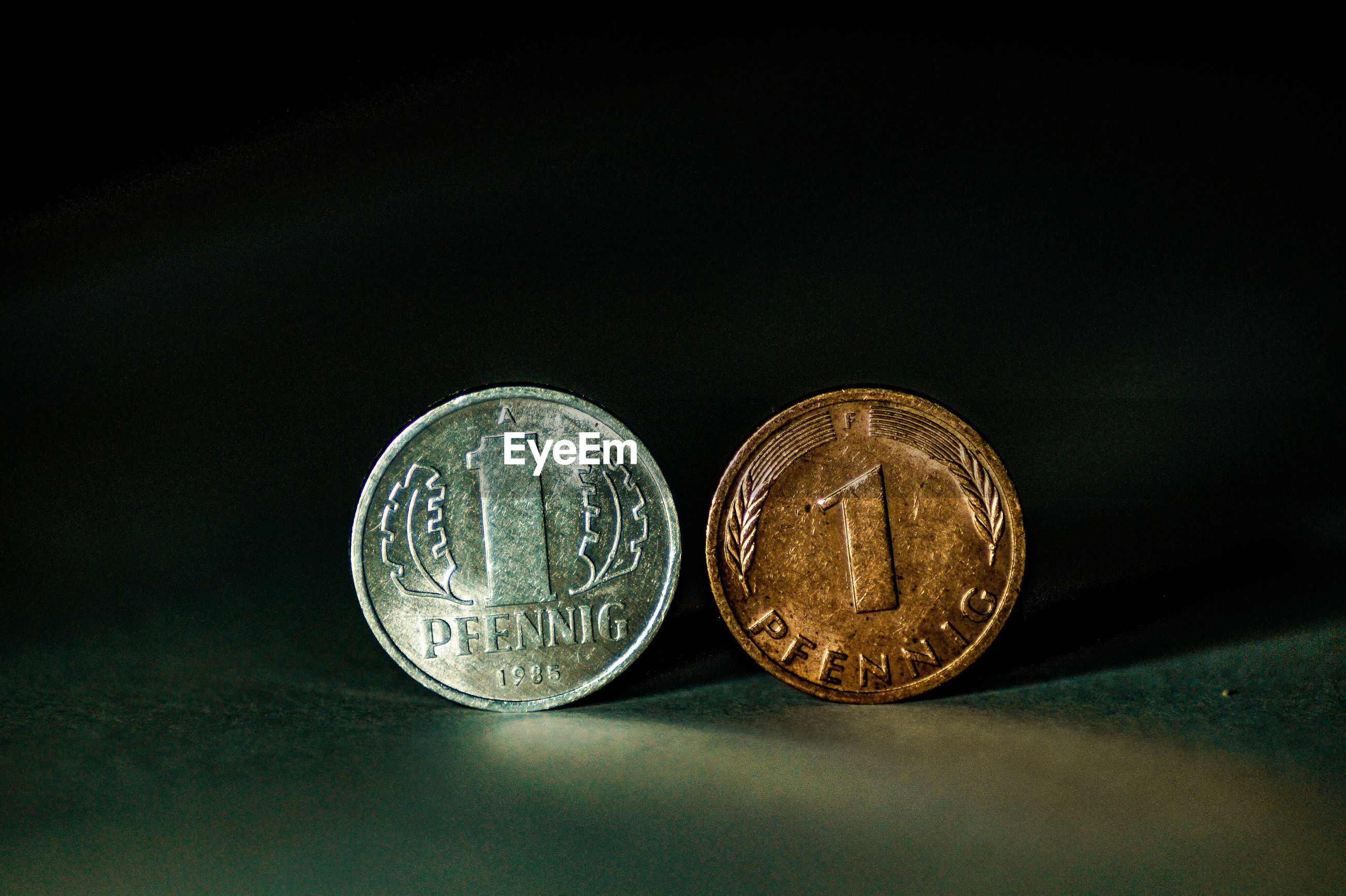 Close-up of coins on black background