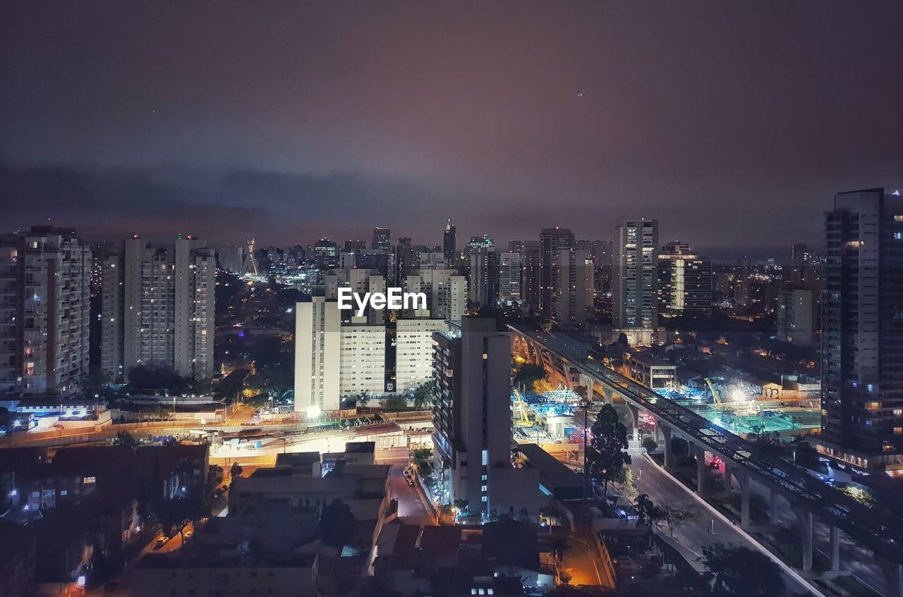 city, building exterior, architecture, built structure, illuminated, sky, cityscape, night, building, office building exterior, skyscraper, cloud - sky, no people, nature, modern, high angle view, urban skyline, city life, tall - high, outdoors, financial district