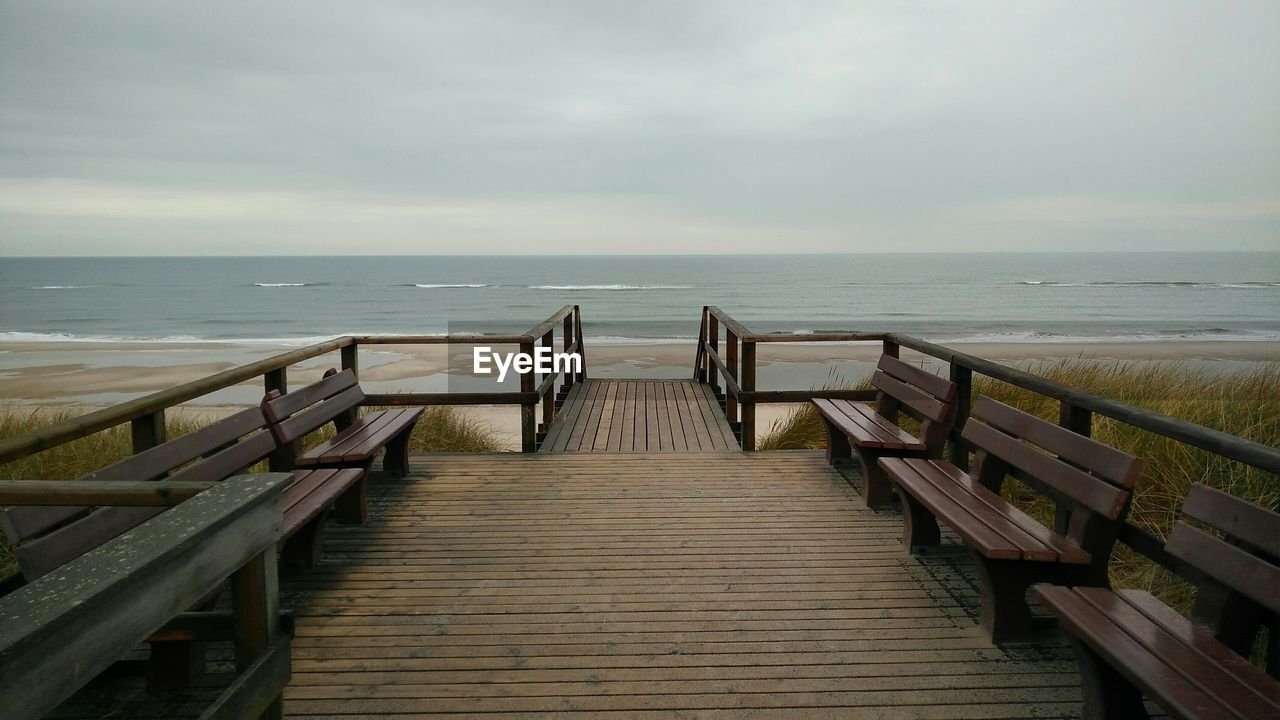 sea, horizon over water, railing, water, nature, beach, tranquility, scenics, sky, tranquil scene, beauty in nature, day, outdoors, wood paneling, no people, hand rail