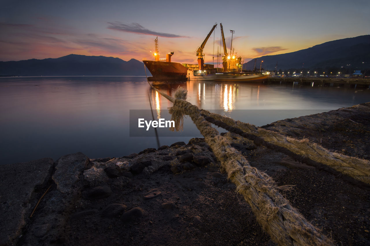 water, sky, sunset, sea, nature, cloud - sky, reflection, industry, no people, rock, solid, outdoors, transportation, rock - object, architecture, beach, nautical vessel, pier, built structure, industrial equipment