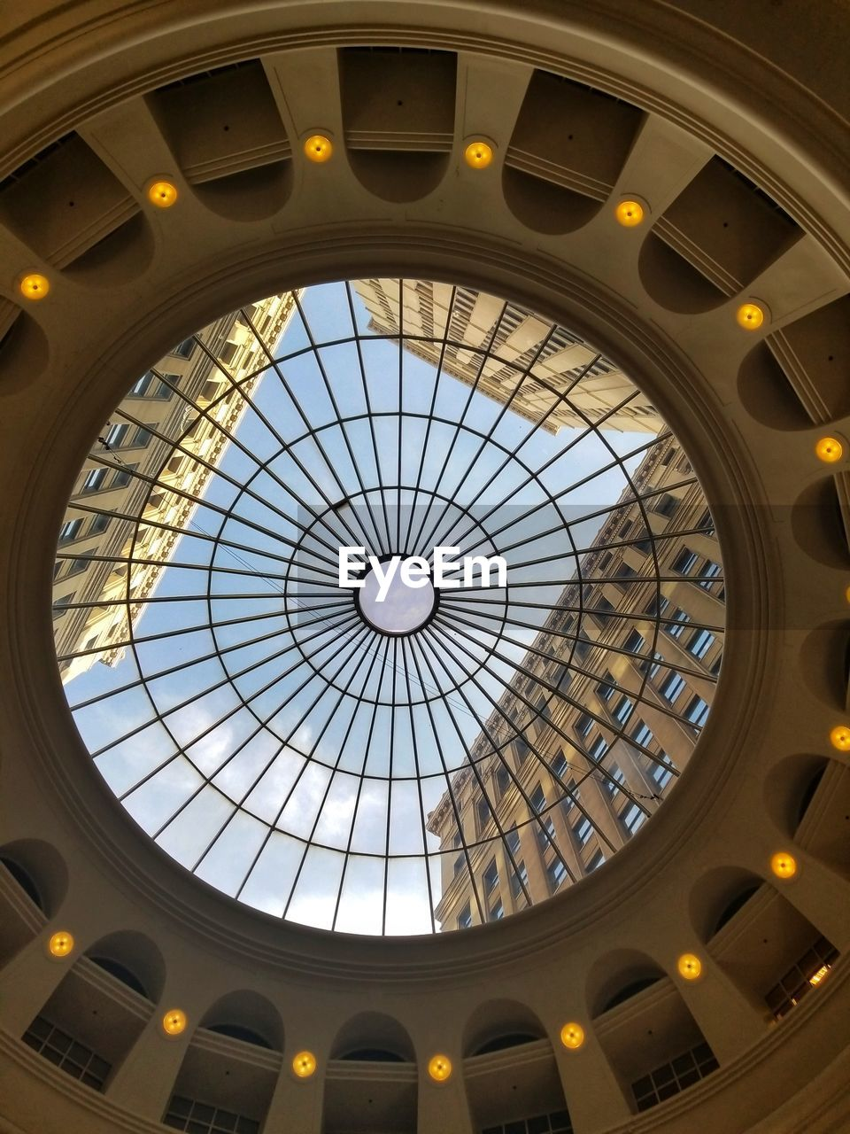 architecture, built structure, ceiling, low angle view, indoors, skylight, geometric shape, no people, pattern, illuminated, shape, circle, glass - material, sunlight, dome, window, architectural feature, directly below, building, cupola, architecture and art, ornate, luxury