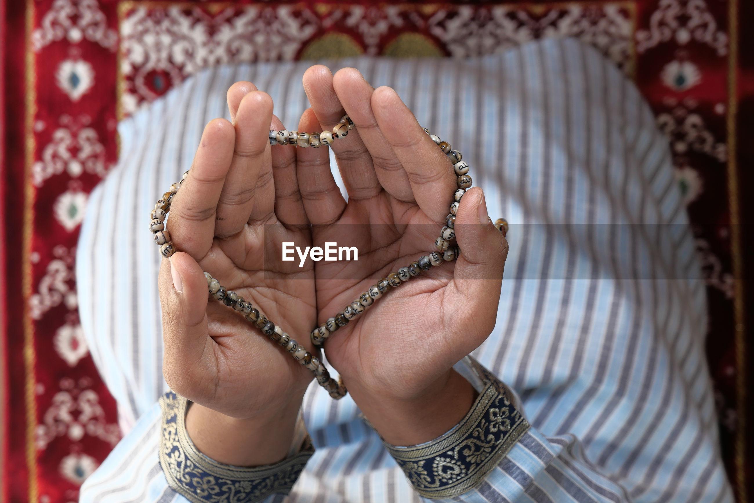 High angle view of muslim man praying. person