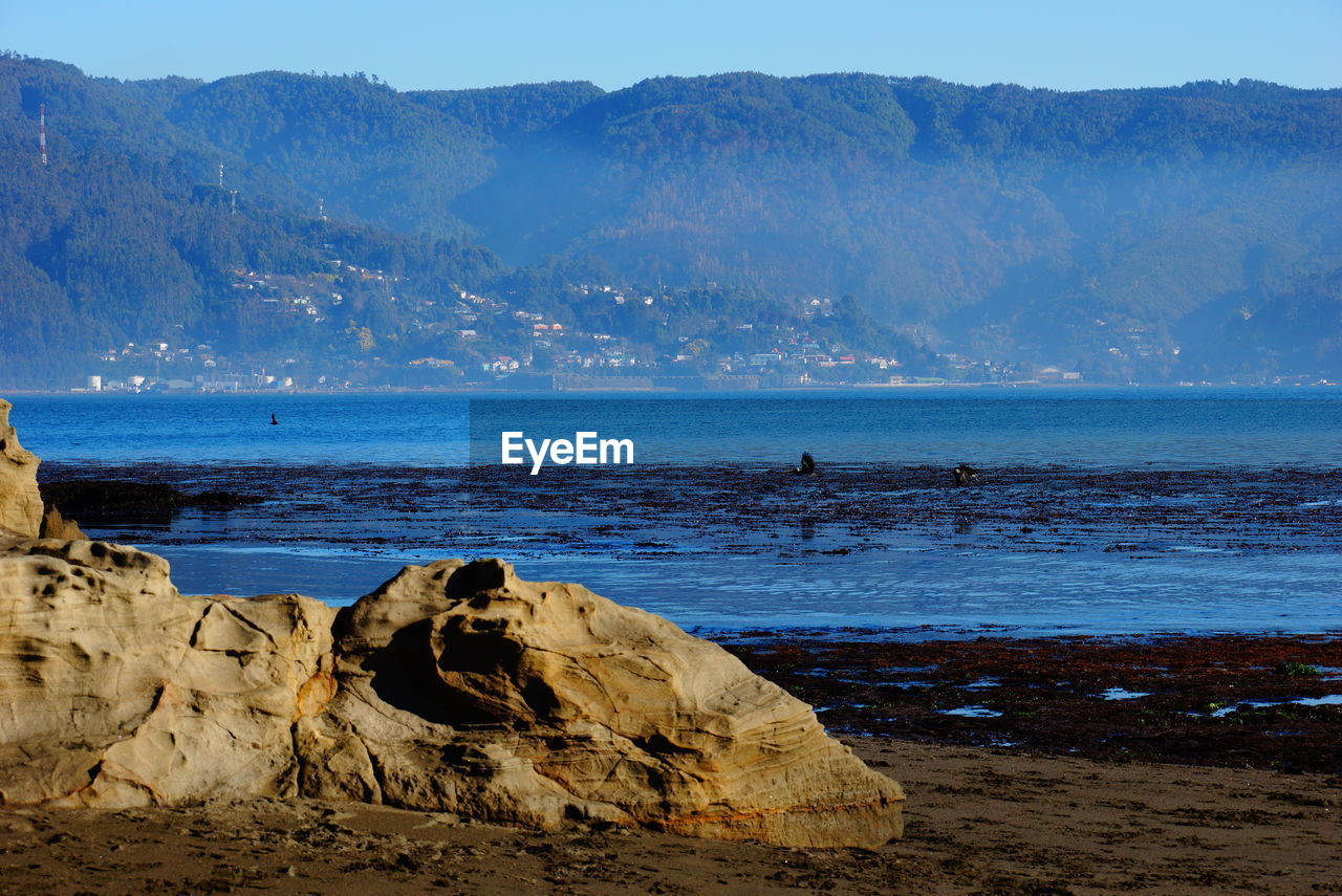 water, beauty in nature, nature, scenics, rock - object, mountain, tranquility, tranquil scene, sea, day, no people, outdoors, beach, sky