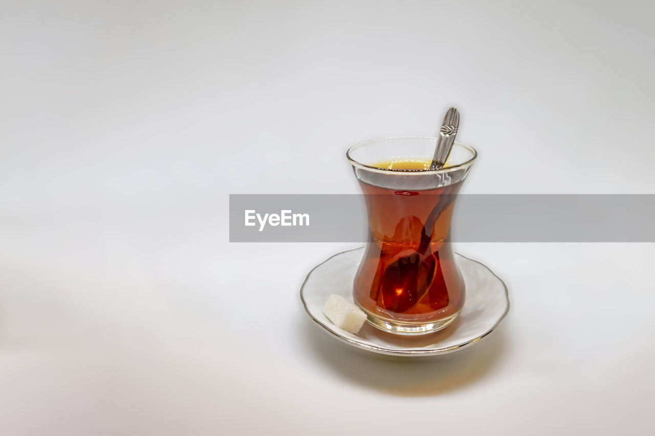 drink, refreshment, food and drink, tea, saucer, tea - hot drink, hot drink, studio shot, white background, indoors, glass, no people, cup, spoon, freshness, close-up, crockery, drinking glass, mug, still life, tea cup, black tea, non-alcoholic beverage