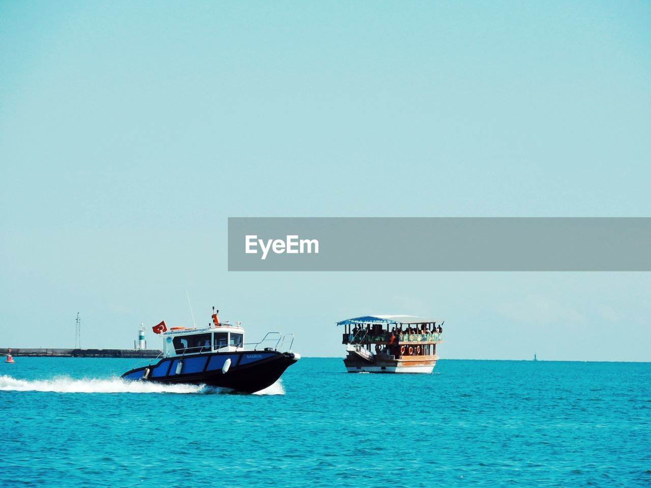 mode of transportation, transportation, nautical vessel, sea, sky, waterfront, copy space, water, nature, clear sky, day, horizon over water, scenics - nature, travel, beauty in nature, sailing, horizon, incidental people, outdoors, passenger craft, turquoise colored