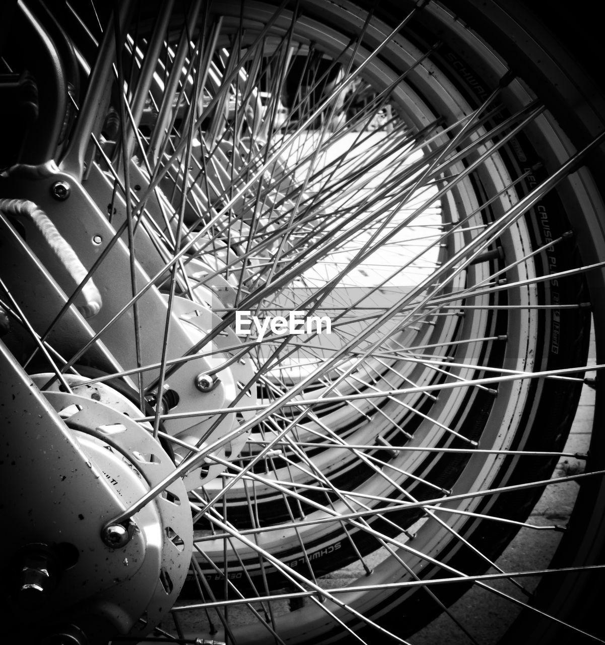 amusement park, amusement park ride, metal, bicycle, land vehicle, spoke, no people, ferris wheel, wheel, transportation, mode of transportation, arts culture and entertainment, built structure, close-up, architecture, day, low angle view, outdoors, fairground, shape, tire, steel