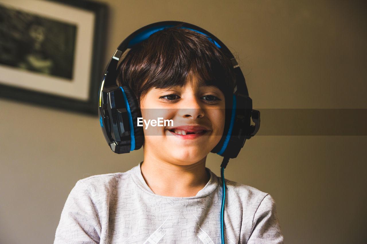 Close-up of smiling boy wearing headphones