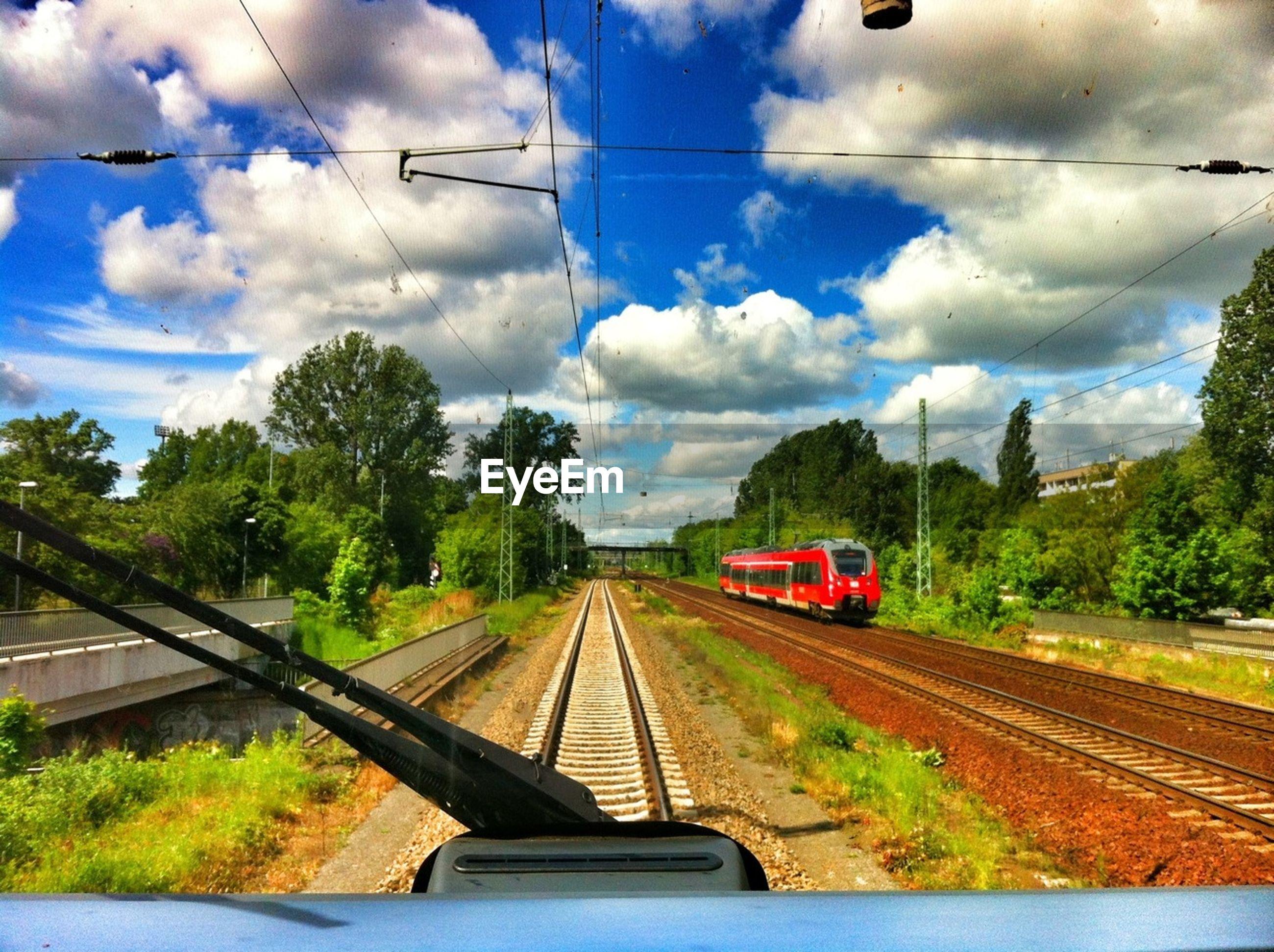 Railroad tracks seen through train windshield