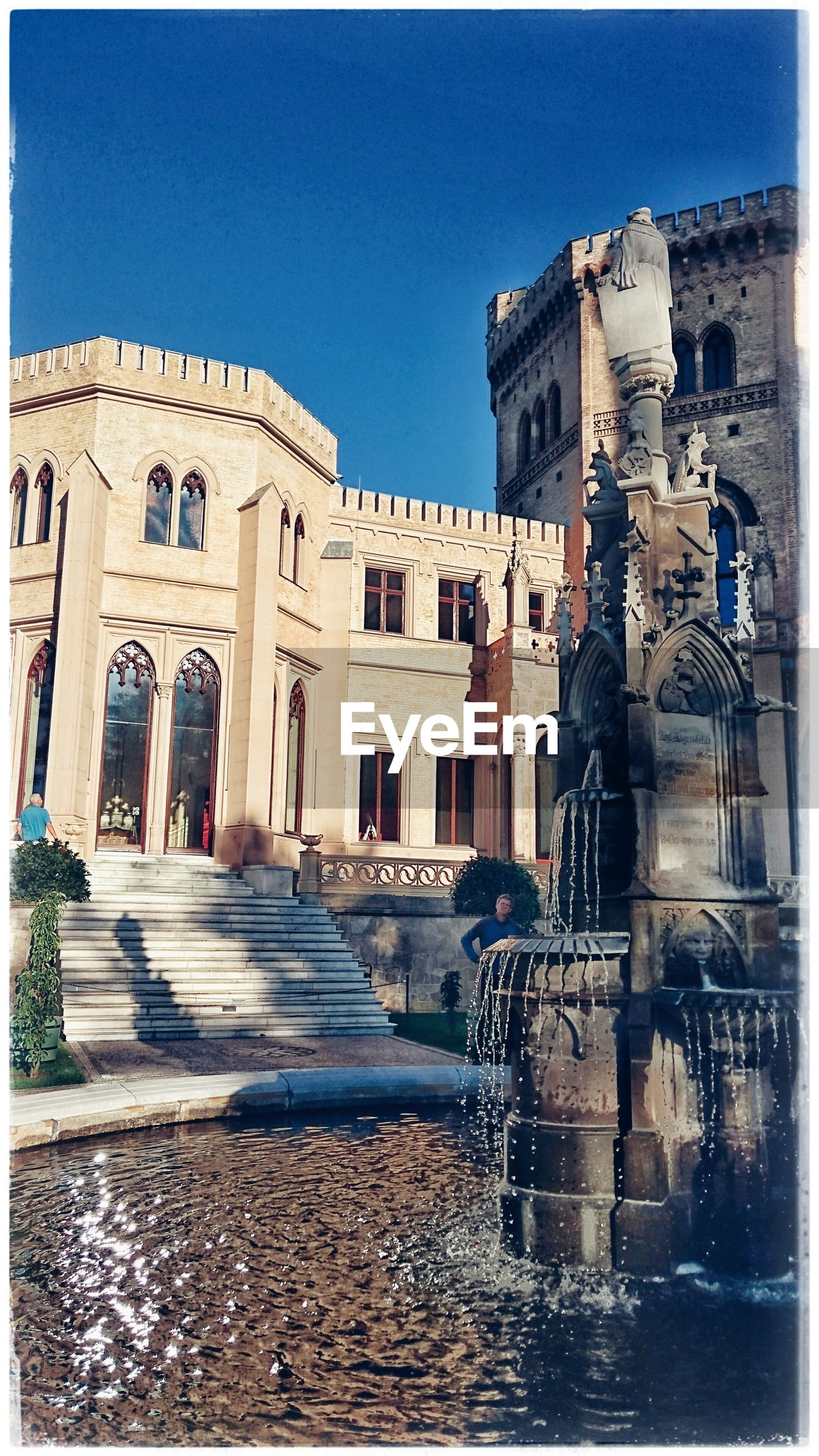 architecture, building exterior, built structure, human representation, statue, blue, sculpture, clear sky, city, travel destinations, art, art and craft, spirituality, famous place, auto post production filter, religion, fountain, in front of, place of worship, facade, history, day, water, outdoors, old town, memories, architectural column