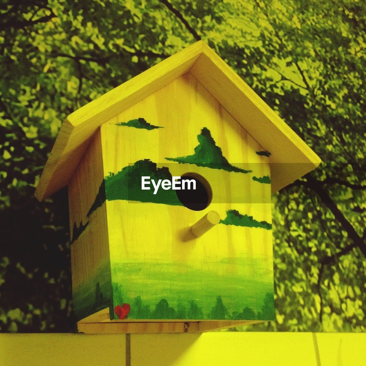 Yellow Painted Birdhouse