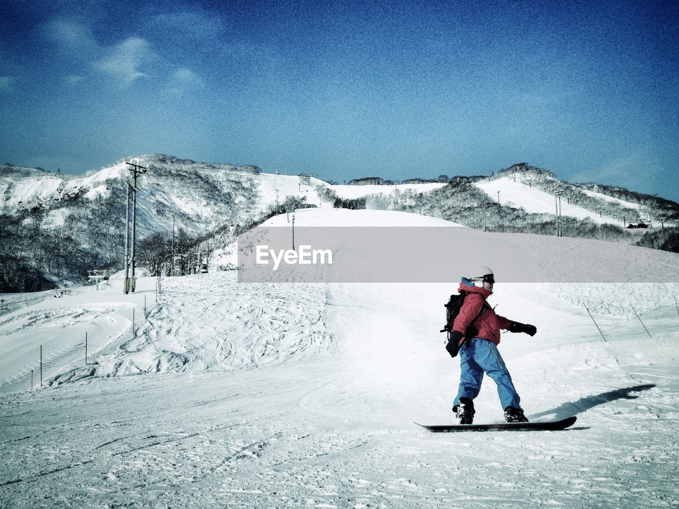 Man snowboarding in mountains