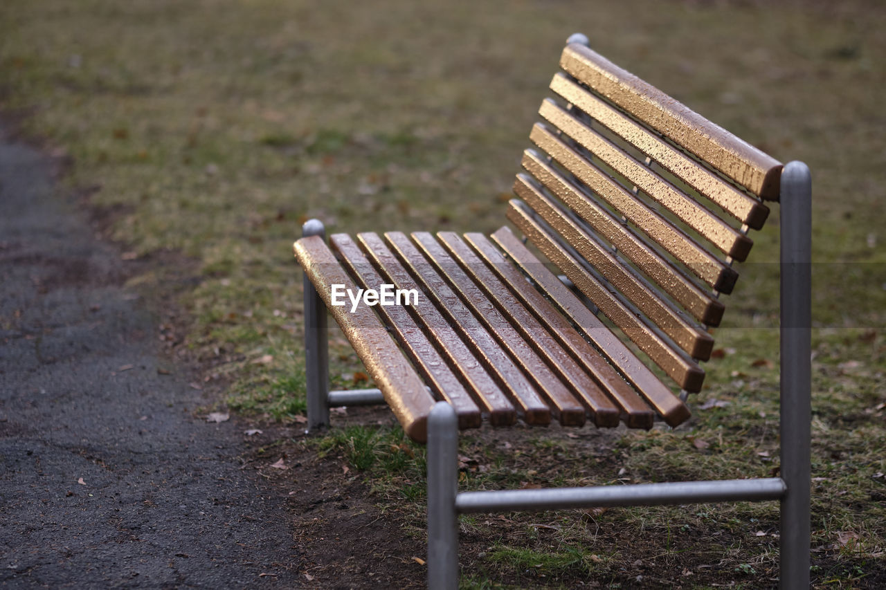 seat, absence, empty, field, bench, no people, nature, park, focus on foreground, land, day, chair, wood - material, park - man made space, grass, park bench, outdoors, plant, high angle view, relaxation, outdoor chair