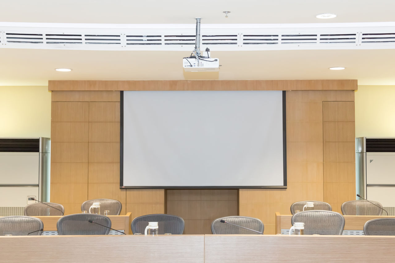 Empty seats in conference room