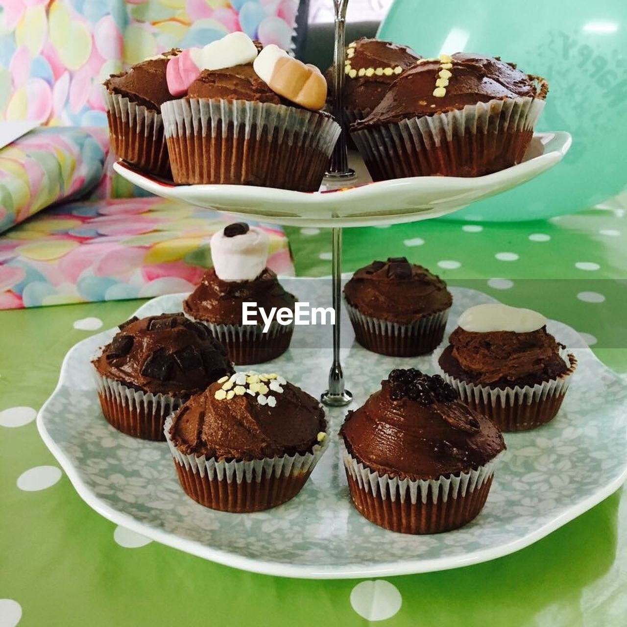 cupcake, sweet food, indulgence, dessert, food and drink, temptation, food, unhealthy eating, freshness, chocolate, ready-to-eat, cake, baked, table, indoors, high angle view, muffin, chocolate cake, sprinkles, no people, whipped cream, close-up, day