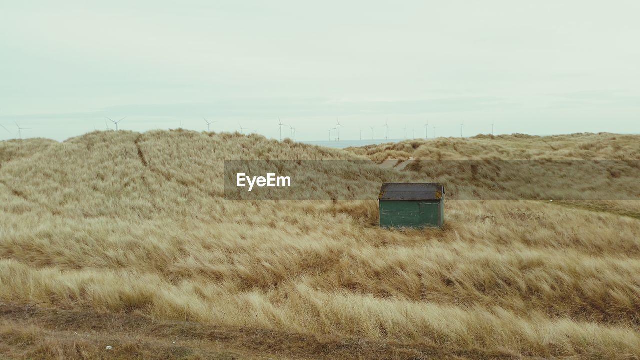 House on grassy field