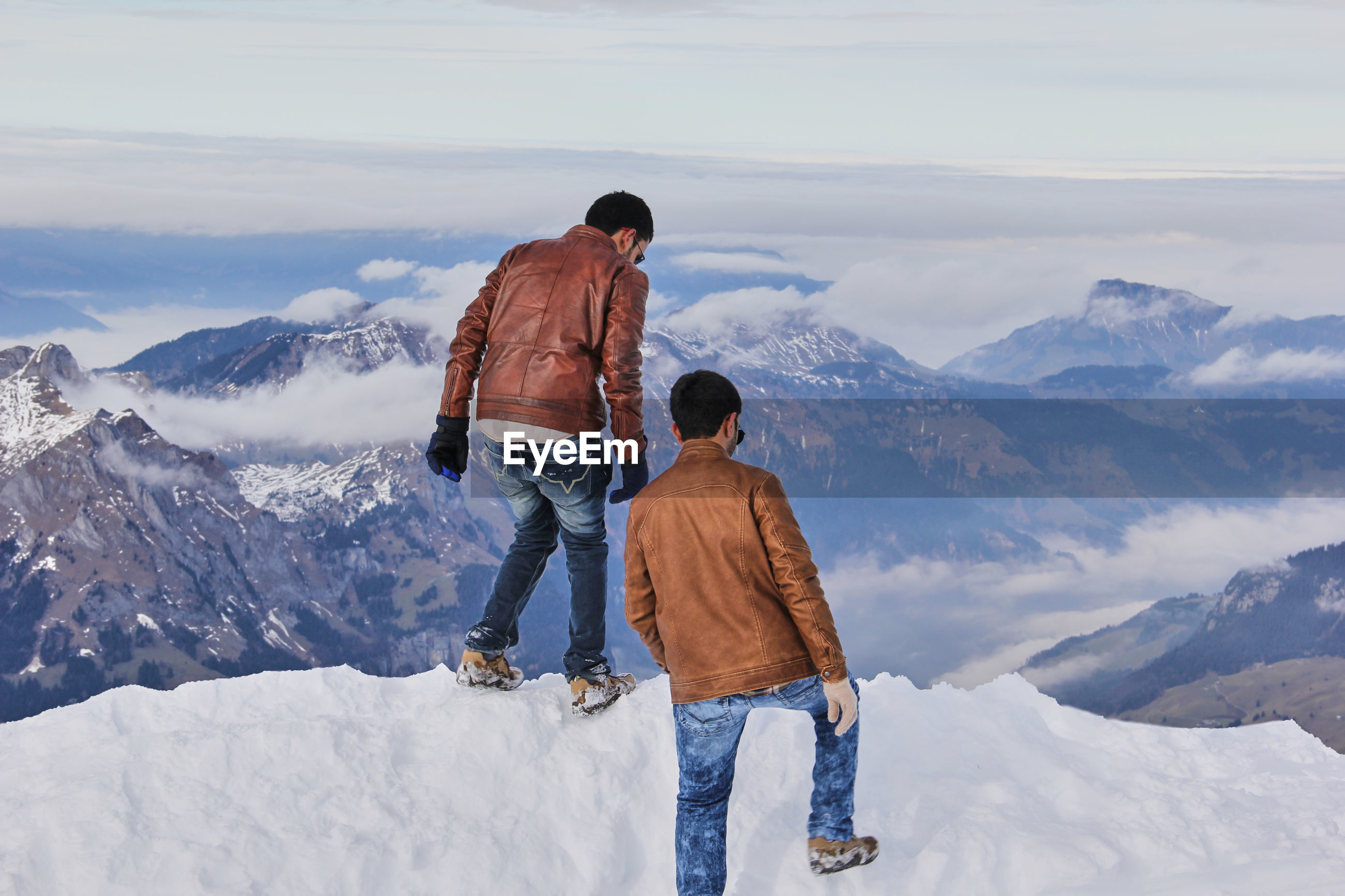 Rear view of two men on the top of a mountain