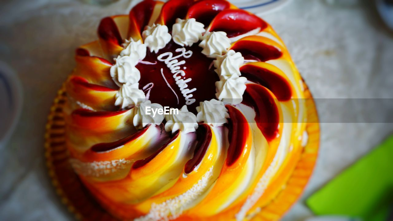 food and drink, sweet food, freshness, food, high angle view, no people, dessert, indulgence, close-up, celebration, indoors, temptation, unhealthy eating, ready-to-eat, flower, day