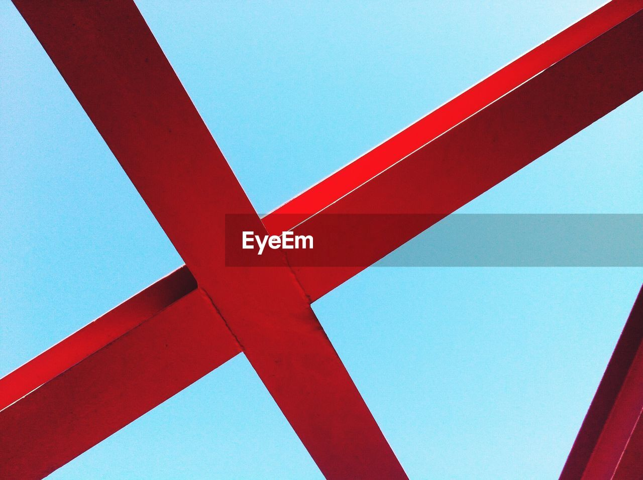 blue, red, low angle view, clear sky, no people, day, sky, close-up, architecture, copy space, metal, built structure, indoors, nature, connection, sunlight, cross shape, pattern, geometric shape