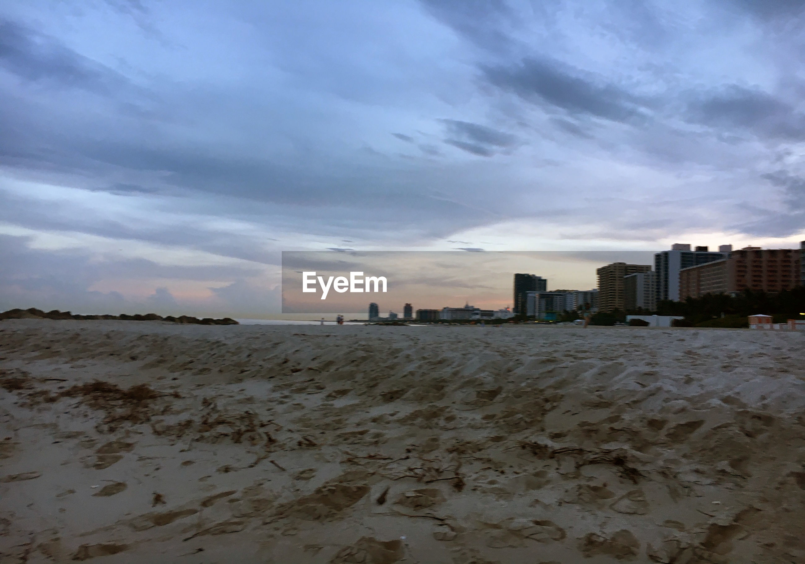 VIEW OF BEACH AND BUILDINGS AGAINST SKY