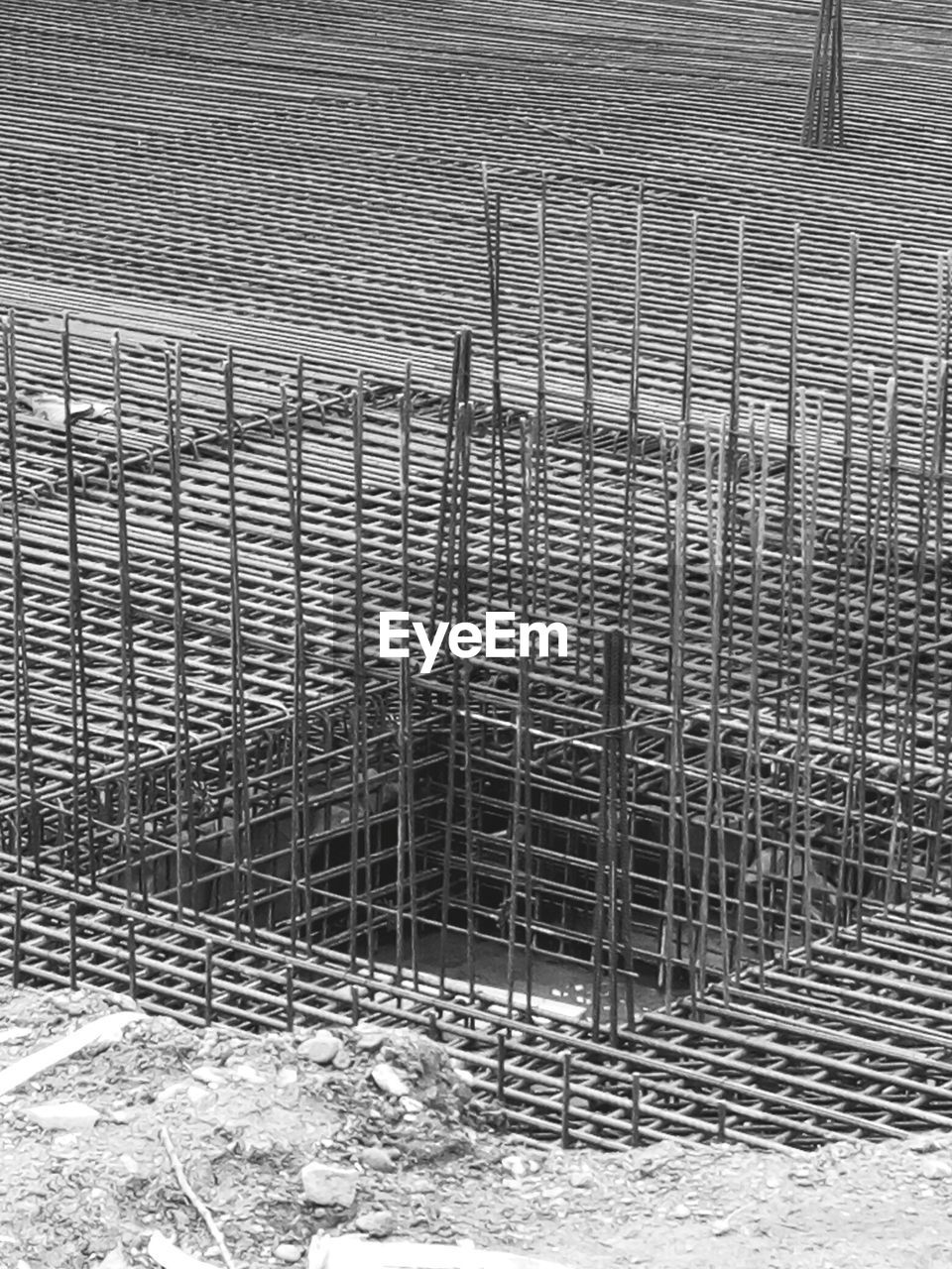 no people, architecture, day, built structure, metal, pattern, outdoors, full frame, barrier, construction site, fence, high angle view, boundary, grid, construction industry, industry, building exterior, protection, security, metal grate