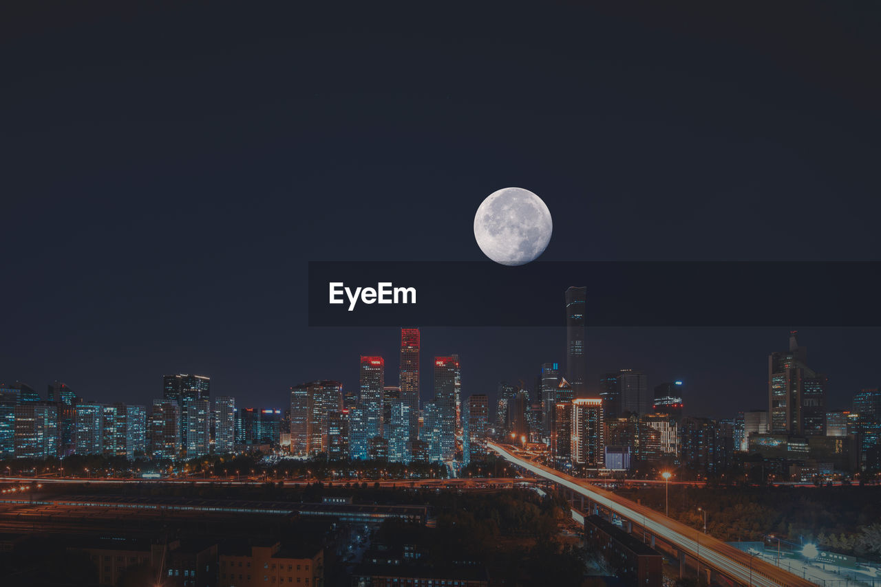 moon, building exterior, night, built structure, architecture, sky, city, illuminated, cityscape, building, nature, no people, full moon, tall - high, urban skyline, planetary moon, skyscraper, outdoors, office building exterior, landscape, astronomy, modern, financial district, moonlight