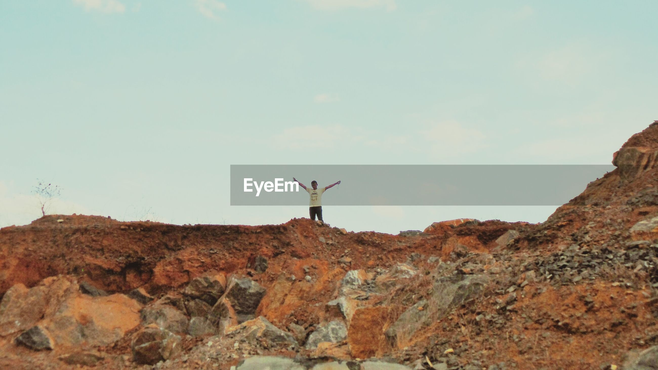 low angle view, sky, mountain, statue, sculpture, rock - object, human representation, cloud - sky, nature, tranquility, day, one person, tranquil scene, travel, landscape, full length, outdoors, scenics, hill