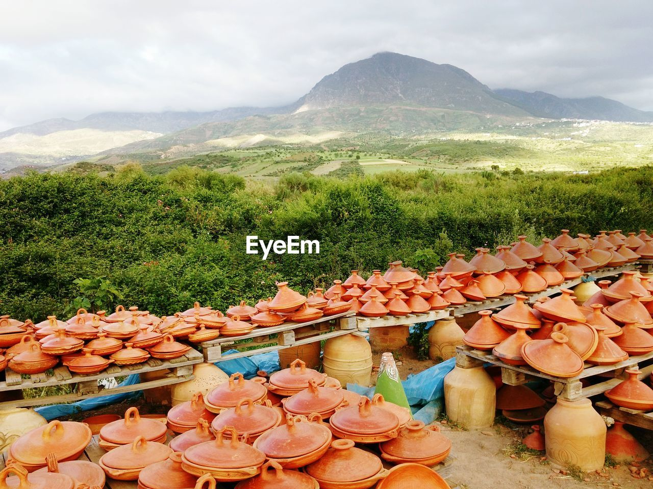 Traditional Pottery For Sale Against View Of Mountains