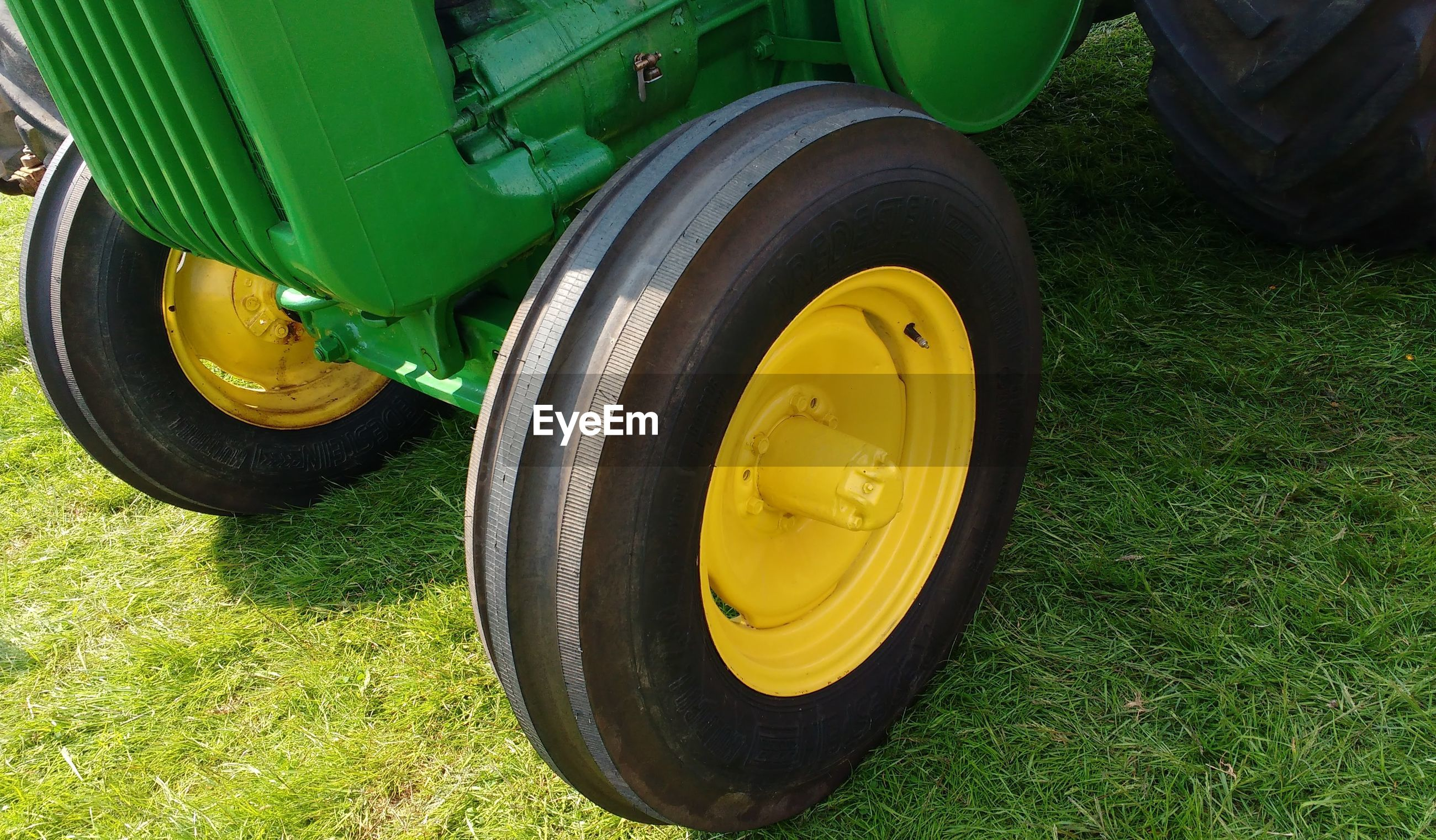 High angle view of yellow tire on field