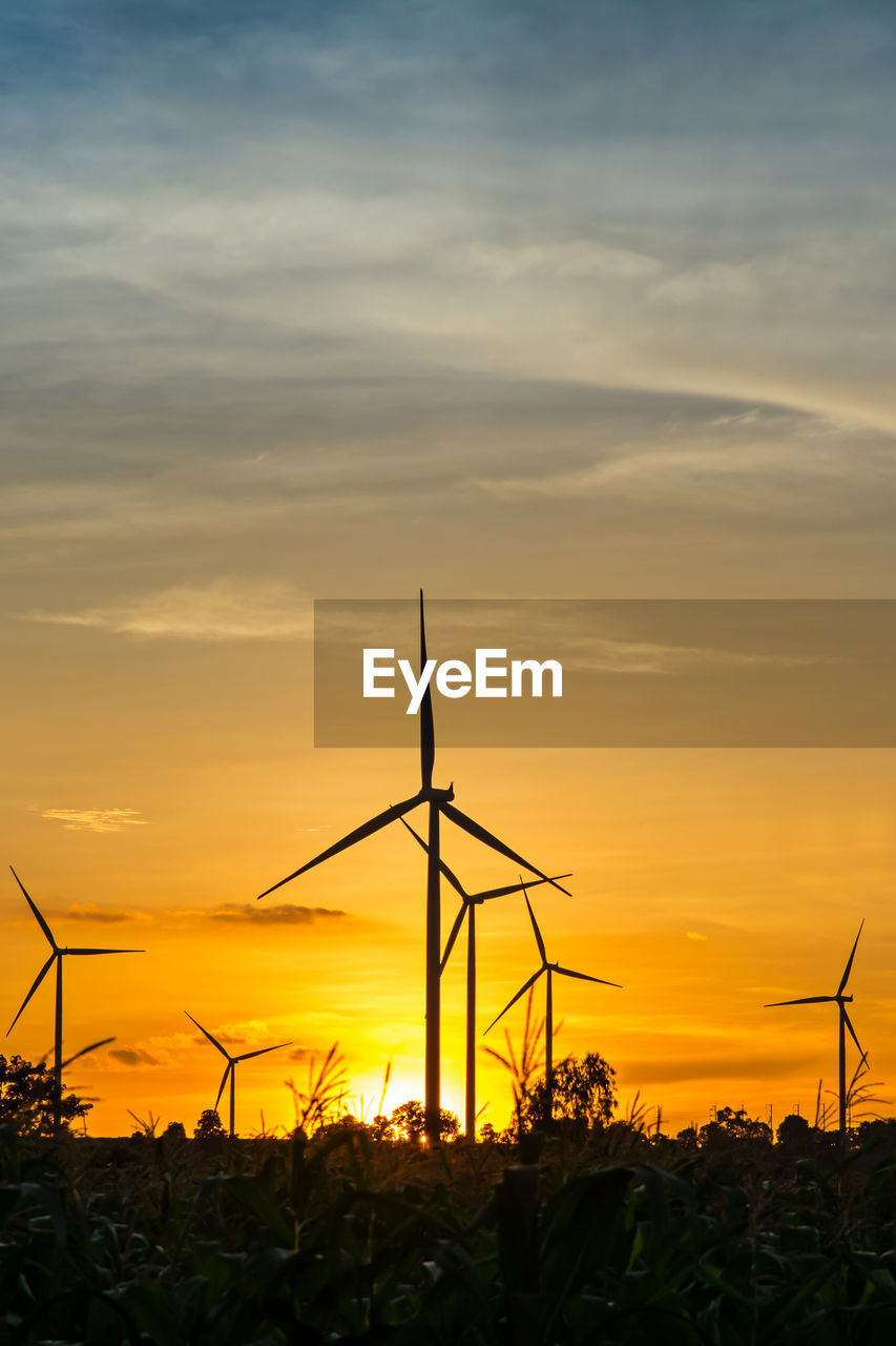 sunset, environmental conservation, sky, orange color, fuel and power generation, cloud - sky, silhouette, environment, beauty in nature, scenics - nature, wind turbine, alternative energy, renewable energy, turbine, no people, field, nature, land, wind power, plant, outdoors, sustainable resources, power supply, romantic sky