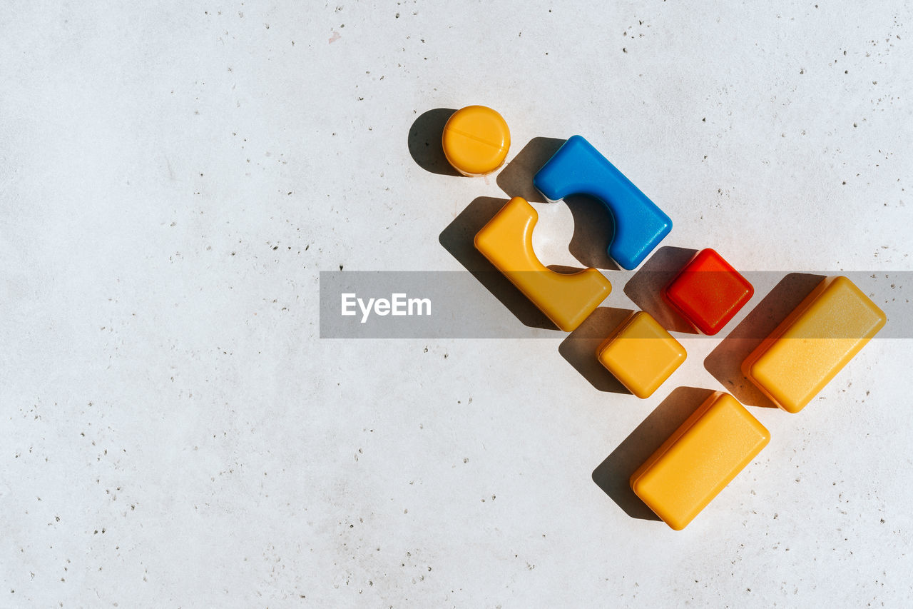 HIGH ANGLE VIEW OF TOYS ON WHITE BACKGROUND