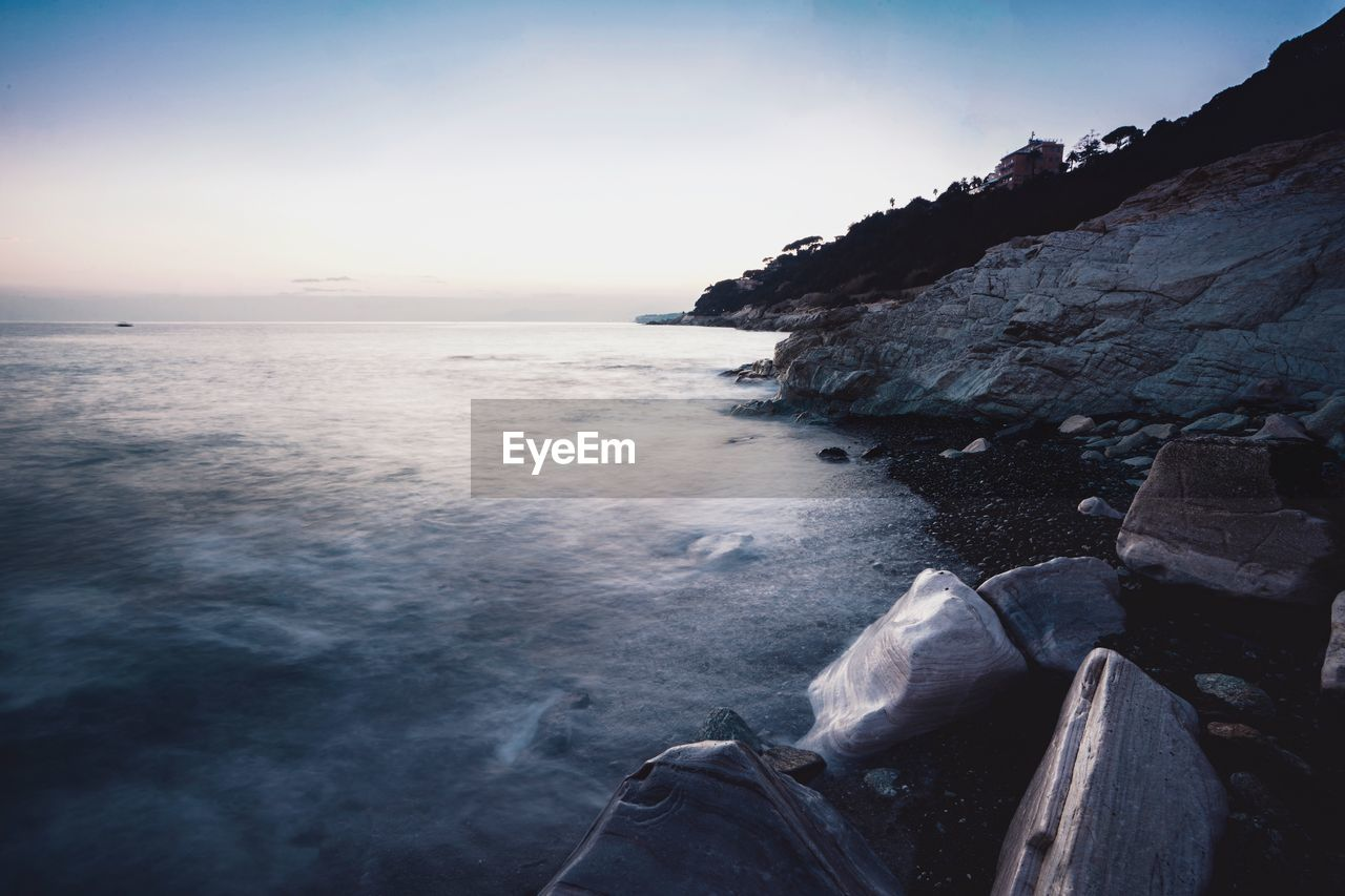 water, sea, sky, scenics - nature, beauty in nature, rock, tranquility, tranquil scene, nature, rock - object, horizon over water, solid, land, horizon, beach, no people, idyllic, day, non-urban scene, outdoors