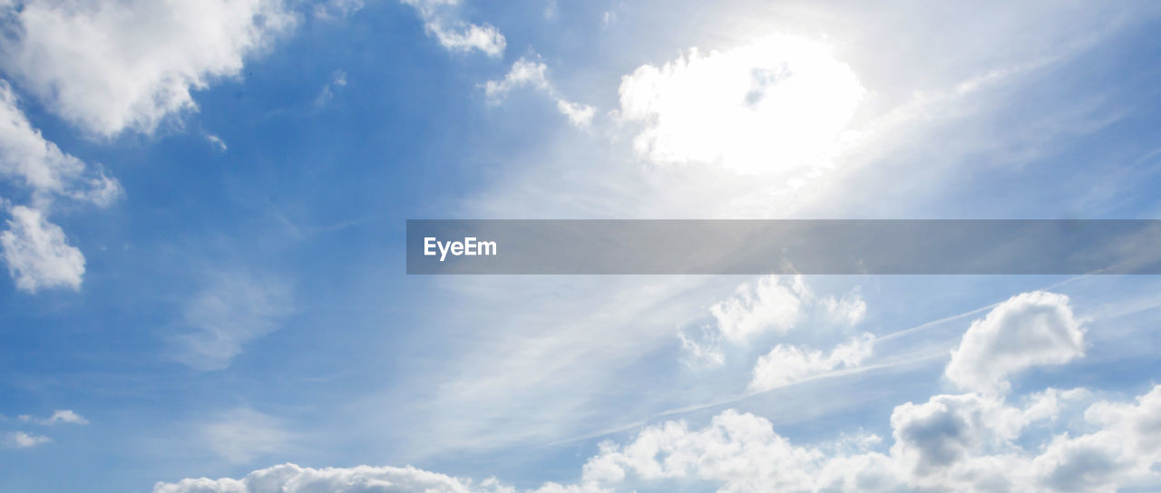 cloud - sky, sky, beauty in nature, nature, white color, sunbeam, scenics, low angle view, blue, sunlight, tranquility, day, sky only, backgrounds, no people, outdoors
