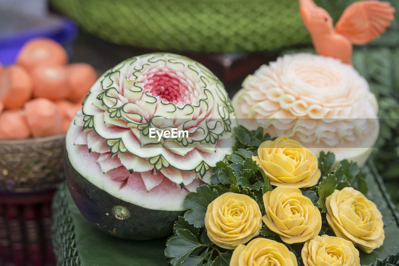Close-up of carved fruits with flowers