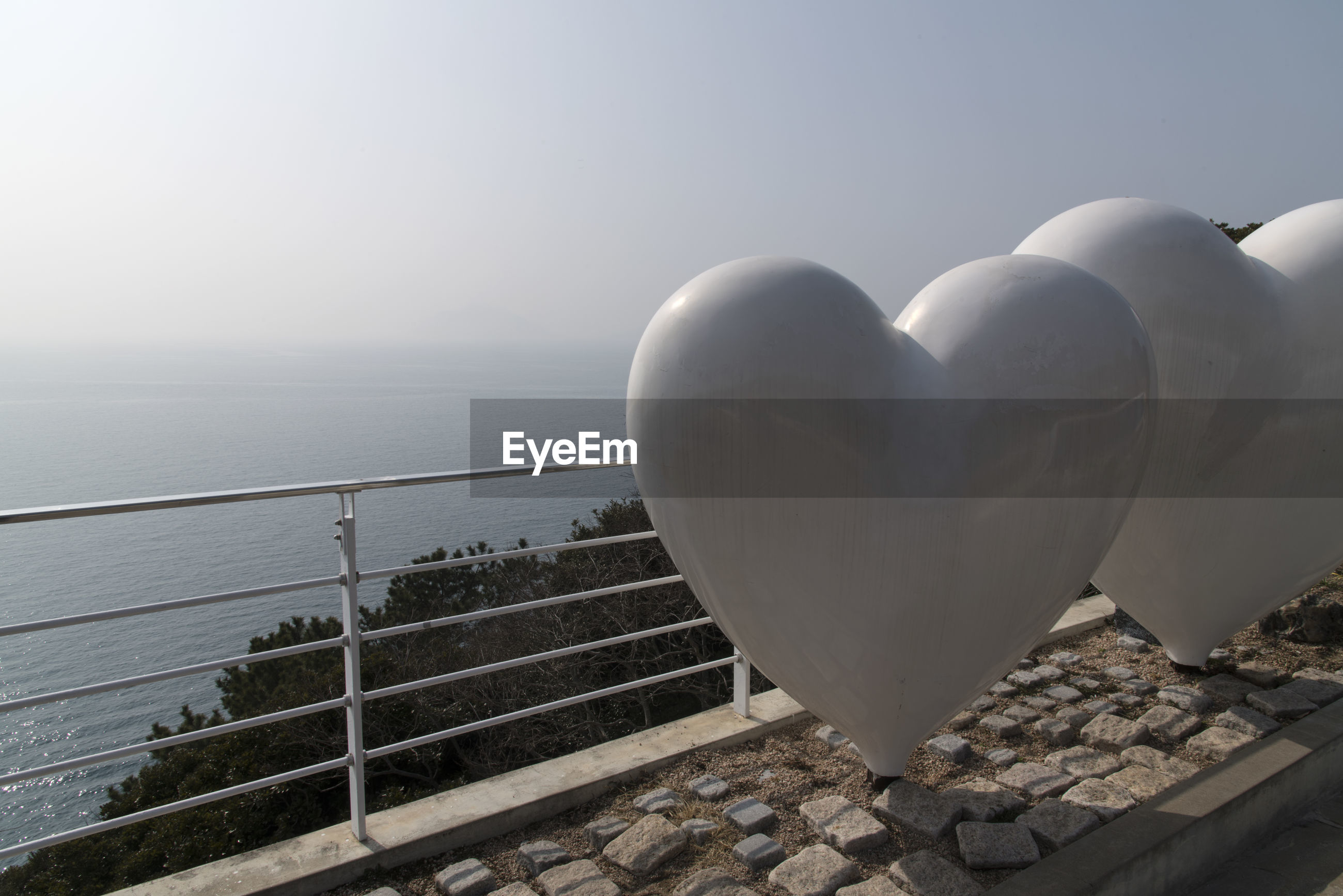 White heart shapes at observation point by sea