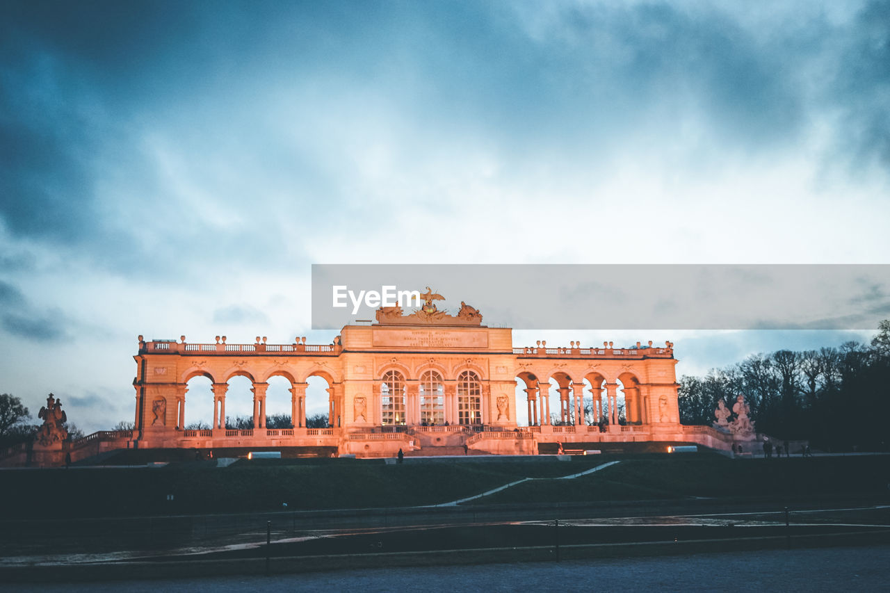 Low Angle View Of Schonbrunn Palace Garden Gloriette Against Cloudy Sky