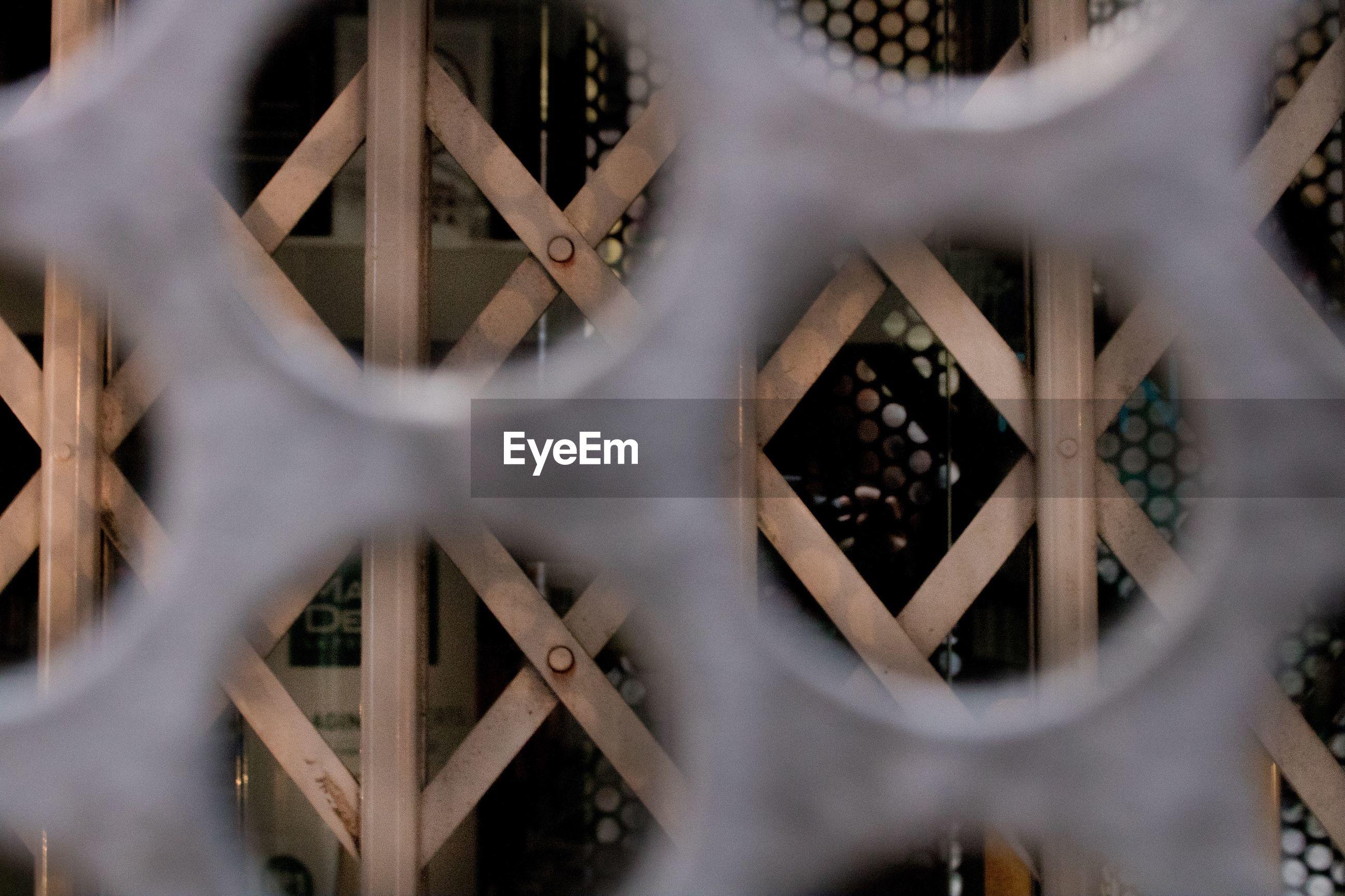 Gate seen through metal grate