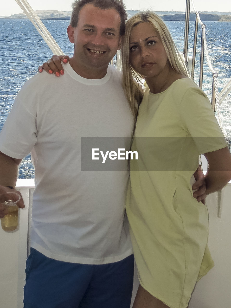 looking at camera, sea, portrait, love, nautical vessel, togetherness, happiness, smiling, two people, water, young adult, vacations, standing, leisure activity, men, young women, sailing, real people, bonding, couple - relationship, yacht, day, outdoors, yachting, people
